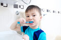 Child portrait brushing teeth, boy dental care, oral hygiene concept, child in bathroom with tooth brush Royalty Free Stock Photo