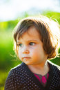 Child portrait in sunlight outdoors summer garden Stock Images