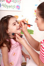 Child preschooler with face painting. Royalty Free Stock Photo