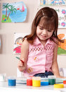 Child preschooler painting in classroom. Stock Image