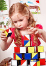 Child preschooler play block in play room. Stock Image