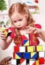 Child preschooler play block in play room. Royalty Free Stock Photo