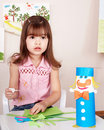 Child preschooler play glue in classroom. Stock Photography