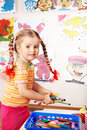 Child prescooler with colour pencil. Royalty Free Stock Photo