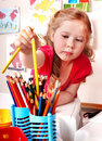 Child prescooler with  pencil in play room. Royalty Free Stock Photo