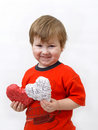 Child presents heart Royalty Free Stock Photos