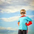 Child pretending to be a superhero with copy space Royalty Free Stock Photography