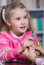 Child psychologist with a little girl draws colored pencils Stock Photography