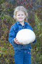 Child with Puff ball mushroom. Royalty Free Stock Image