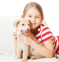 Child and puppy a golden Stock Photo