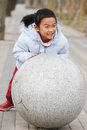 Child push stone ball Stock Photos
