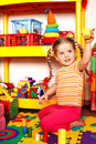 Child with puzzle and wood block  in play room. Stock Photography