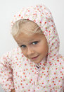 Child in raincoat a cute girl dressed up for rain pink rain and windproof coat with hood Stock Photos