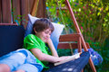 Child reading a book in the garden Royalty Free Stock Photo
