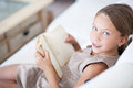 Child reading book portrait of years old on the sofa at home Stock Photography