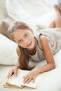 Child reading book portrait of years old on the sofa at home Royalty Free Stock Images