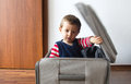 Child ready to go in suitcase Royalty Free Stock Image