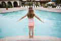 Child ready to play in a big swimming pool Royalty Free Stock Photo