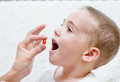 Child receiving pill - closeup Royalty Free Stock Photo