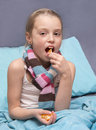 Child is recovering from an illness school age and eating vitamins Royalty Free Stock Image