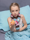 Child is recovering from an illness school age and holds slices of mandarin Stock Photo