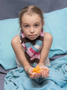 Child is recovering from an illness school age and holds slices of mandarin Stock Photography