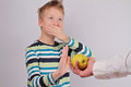 Child refuses to eat fruits apple Royalty Free Stock Photo