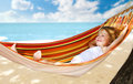 Child relaxing in a hammock Stock Photo