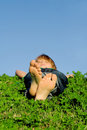 Child relaxing sleeping outdoors Royalty Free Stock Photo