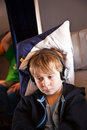 Child is relaxing and watching a film in an aircraft in business Royalty Free Stock Photo