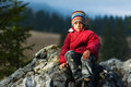 Child resting on cliff Royalty Free Stock Photo
