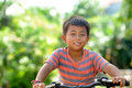 Child Riding Bicycle Stock Image