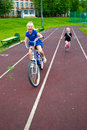 Child riding a bicycle girl rides on the playground Royalty Free Stock Photography
