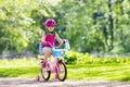 Child riding bike. Kid on bicycle. Royalty Free Stock Photo