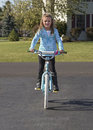Child riding bike a young girl a Royalty Free Stock Photo