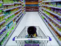 Child riding a grocery cart in a grocery photo of while inside or supermarket Stock Photos