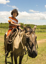Child Riding Horse in a Farm Royalty Free Stock Photo