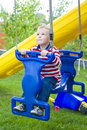 The child riding a swing four year old Royalty Free Stock Photo