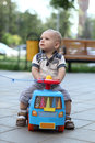 Child riding toy car Stock Images