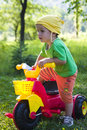 Child riding tricycle Stock Photo