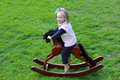 Child on rocking-horse Royalty Free Stock Photography