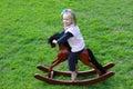 Child on rocking-horse Royalty Free Stock Photo