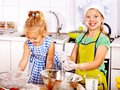 Child with rolling pin dough at kitchen Royalty Free Stock Photos