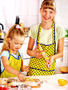 Child with rolling pin dough at kitchen Stock Photo