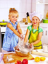 Child with rolling pin dough at kitchen Stock Images