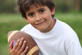 Child with rugby ball little boy a Royalty Free Stock Photos