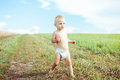 Child running in a field Royalty Free Stock Photo