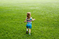 Child running meadow young through a Royalty Free Stock Photos