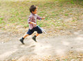 Child running in a park motion blur Royalty Free Stock Photography