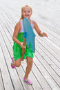 Child running with a wooden horse girl quickly jumps on Royalty Free Stock Images